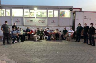 Ak Parti heyeti kan bağışında bulundu